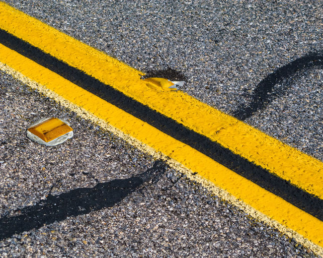 interesting abstract structure and yellow line on the road Abstract Photography Asphalt LINE Road Traffic Abstract Art Asphalt Road Black Detail Lines And Shapes Middle Line No People Outdoors Road Marking Street Yellow