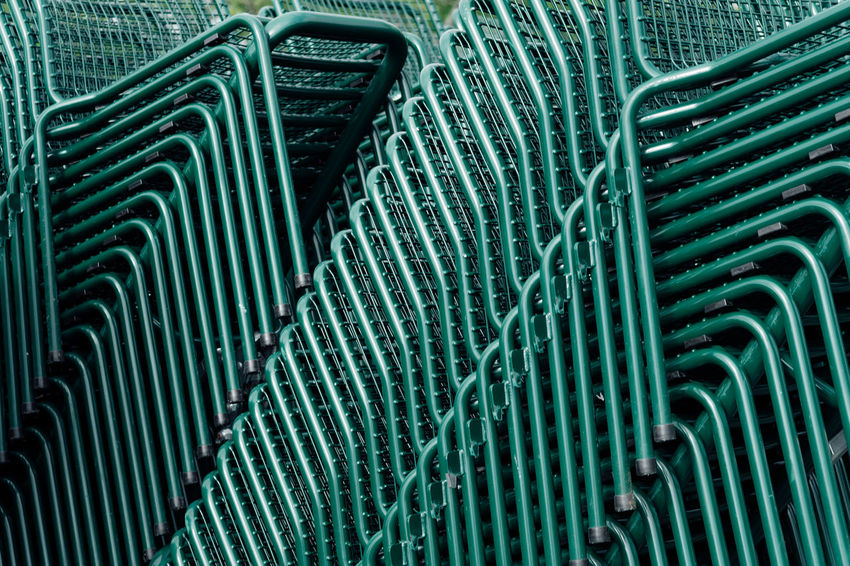 Large group of metal chairs Green Architecture Background Backgrounds Built Structure Chairs Close-up Day Full Frame High Angle View Large Group Of Objects Metal No People Pattern Repetition Silver Colored Textured