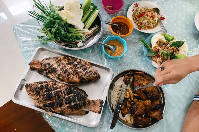 High angle view of person preparing thai food on table