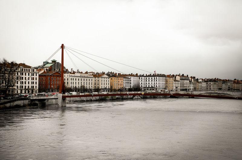 Passerelle du palais de justice over saone river against cloudy sky