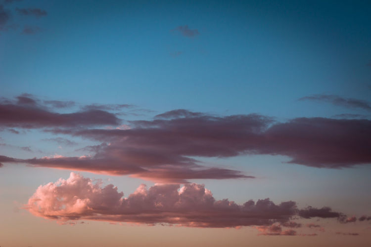 Sky Cloud - Sky Beauty In Nature Outdoors Dramatic Sky Sunset Nature Environment Tranquility Non-urban Scene No People Blue Orange Color