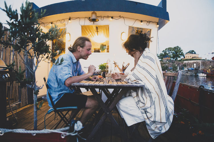 People sitting on table at cafe