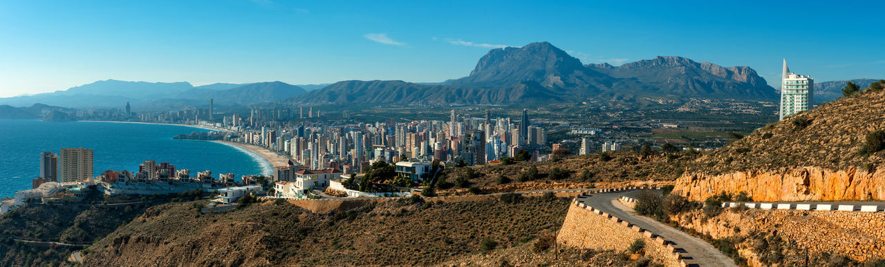 Panoramic view to the Benidorm city. Benidorm is a coastal city in Alicante, Costa Blanca. Spain Aerial View Alicante, Spain Architecture Benidorm Spain Blue Sky City Cityscape Coast Coastline Costa Blanca Famous Place Highrise Landscape Mediterranean Sea Modern Architecture Mountain Range Panorama Panoramic View Picturesque Real Estate Resort Skyscrapers SPAIN Sunny Day View From The Top