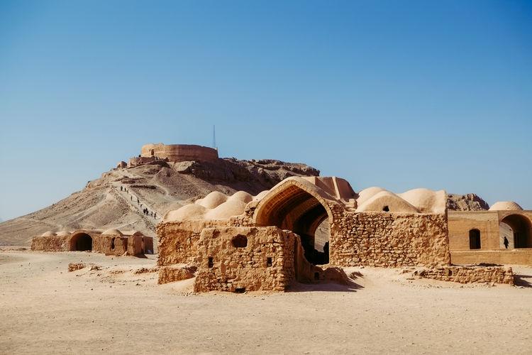 Ruin and ancient buildings near zoroastrian dakhma. persian tower of silence in yazd, iran.