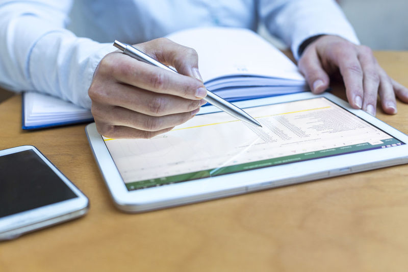 Accounting on a tablet computer, close-up Account Accounting Analytics Audit Bookkeeping Business Businesswoman Calculation Chart Close Up Data Desk Editing Hands Lifestyle Modern Office Pen Record Smartphone Tablet Taxes Technology Touch Work