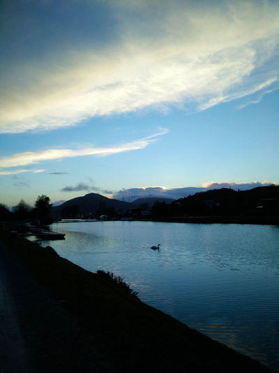 Beauty In Nature Caledonian Canal Day Mountain Nature No People Outdoors Reflection Scenics Silhouette Sky Sunset Swan Tranquil Scene Tranquility Water Water Bird