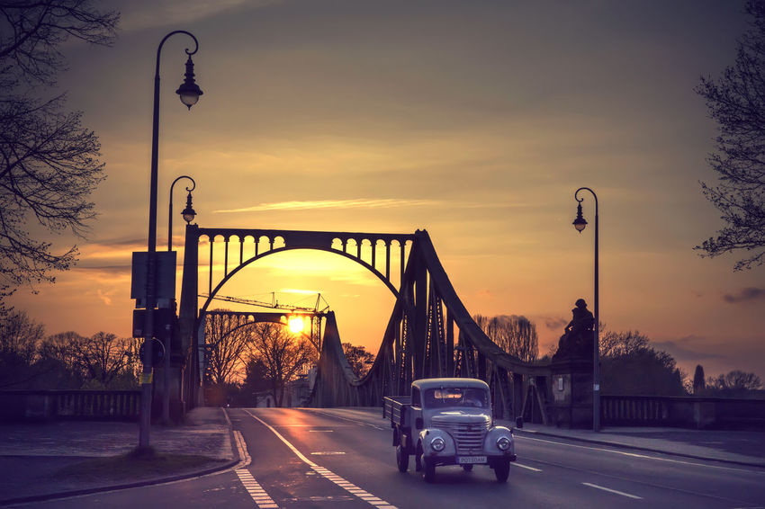 Berlin Glienicker Brücke Potsdam Architecture Bridge Bridge - Man Made Structure Building Exterior Built Structure Car City Glienicke Bridge Land Vehicle Mode Of Transport Nature No People Oldtimer Outdoors Road Sky Street Street Light Street Photography Sunset The Way Forward Transportation