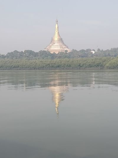 Reflection Water Waterfront Lake Nature Sky Tranquility Built Structure Architecture No People Tranquil Scene Scenics - Nature Building Exterior Beauty In Nature Tree Religion Plant Outdoors Symmetry Spire