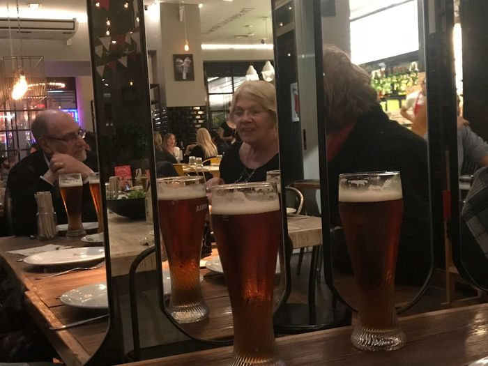 Mirror Mirror Food And Drink Refreshment Alcohol Drink Bar - Drink Establishment Adult People Indoors  Men Glass - Material Real People Lifestyles Group Of People Night Bar Counter Business Reflection Glass Mirror Leisure Activity