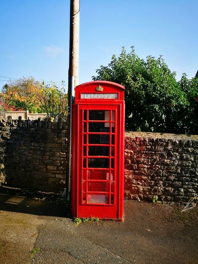 Red Tree Communication Outdoors Day No People Telephone Booth Sky British Phone Box Telegraph Pole Red Phone Box