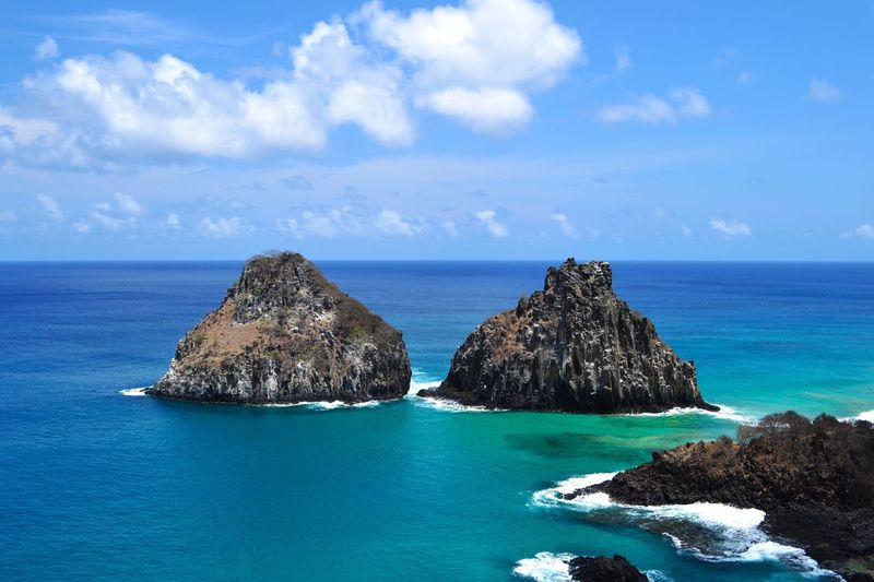 Sea Horizon Over Water Sky Scenics Nature Beauty In Nature Outdoors Cloud - Sky Rock - Object Tranquil Scene Two Brothers In Fernando De Noronha Two Brothers Rock Beach Beach Photography Island Landscape Landscape_photography Islands Archipelago in Fernando De Noronha Island Fernando De Noronha Brazil