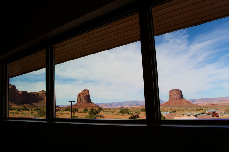 Sky Window Cloud - Sky No People Day Nature Architecture Glass - Material Mountain Indoors  Built Structure Transparent Landscape Scenics - Nature Travel Transportation Environment Land Beauty In Nature Architectural Column Window Frame Monument Valley Arizona Desert Arizona Sky