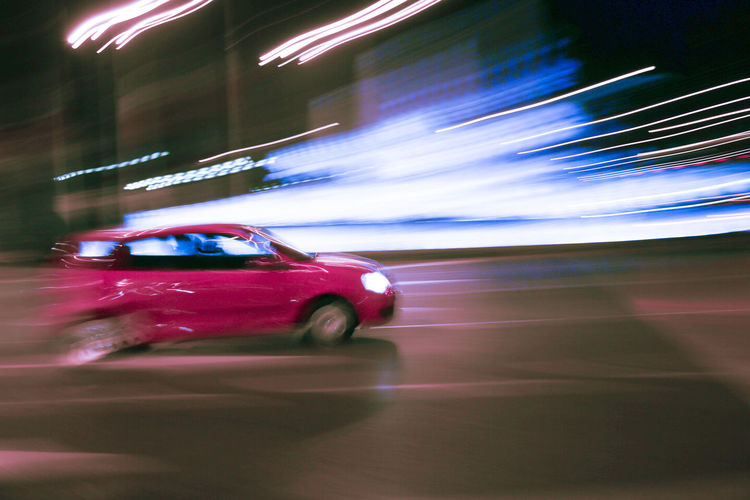 A car in the Plaza de Cibeles in Madrid, Spain Blurred Motion Car Glowing Journey Mode Of Transport On The Move Road Shiny Spain, Madrid, Tourism, Tourist, Buildings Speed Street Transportation Travel