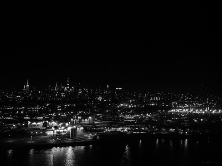 Somewhere in New York Colorless EyEmNewHere Reflection Architecture Blackandwhite Building Exterior Built Structure City Cityscape Illuminated Laguardia Newyork Newyorkcity Night Nightscape No People Outdoors River Sky Skyscraper Travel Destinations Water