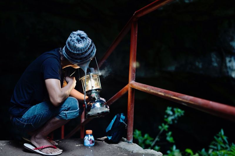 Showcase: January Eyeem Philippines Taking Photos Light And Shadow Creative Light And Shadow Deceptively Simple Minimalism our tour guide preparing his lamp during our spelunking experience in Sumaguing cave, Sagada.