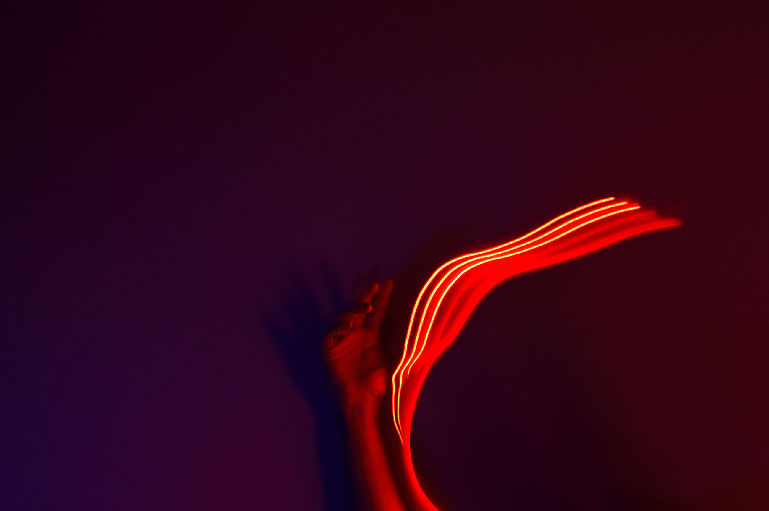 red, studio shot, motion, indoors, copy space, no people, close-up, nature, glowing, colored background, cut out, heat - temperature, illuminated, abstract, black background, creativity, orange color, long exposure, pattern, smoke - physical structure