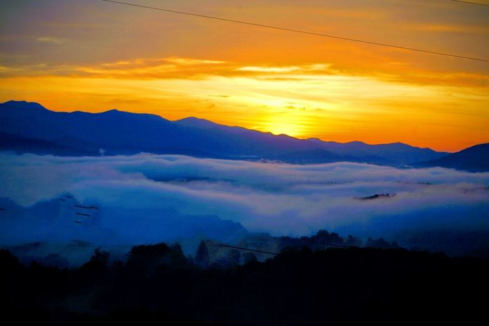 Sunrise in the Blue Ridge Mountains Sky Scenics - Nature Sunset Beauty In Nature Mountain Tranquil Scene Tranquility Cloud - Sky Silhouette Mountain Range Idyllic Environment Nature Landscape No People Dramatic Sky Orange Color Majestic Sun