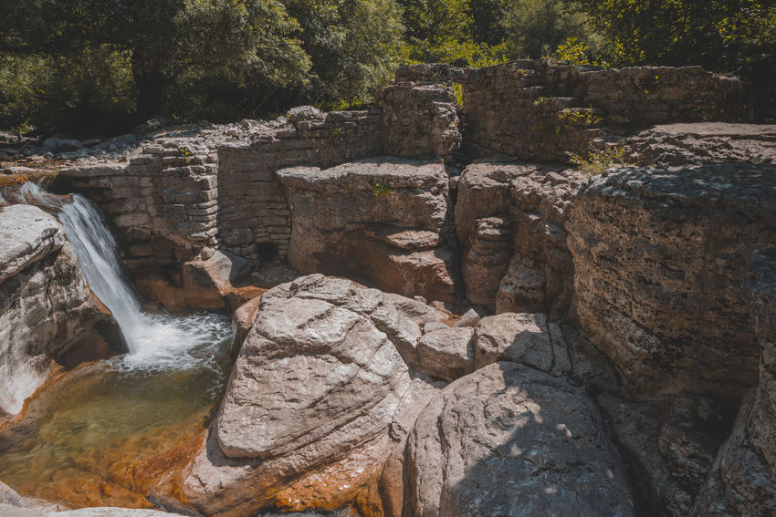 Kinchkha Beauty In Nature Day Eroded Flowing Flowing Water Forest Land Nature No People Outdoors Plant Rock Rock - Object Rock Formation Scenics - Nature Solid Tranquility Travel Travel Destinations Tree Water Waterfall