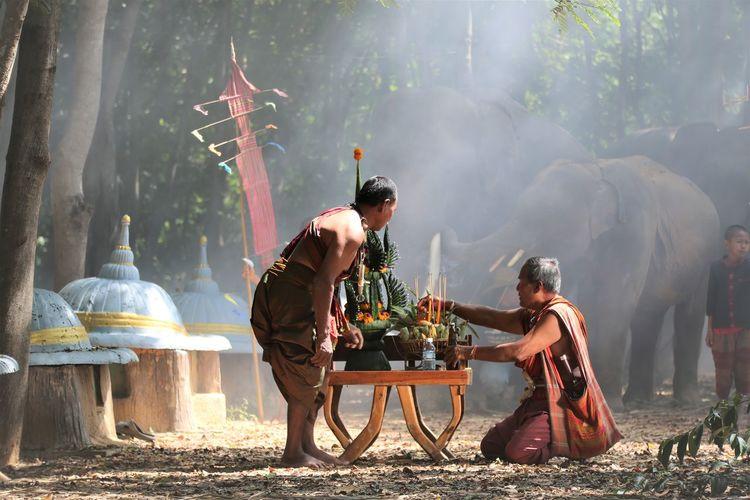 Men praying by table