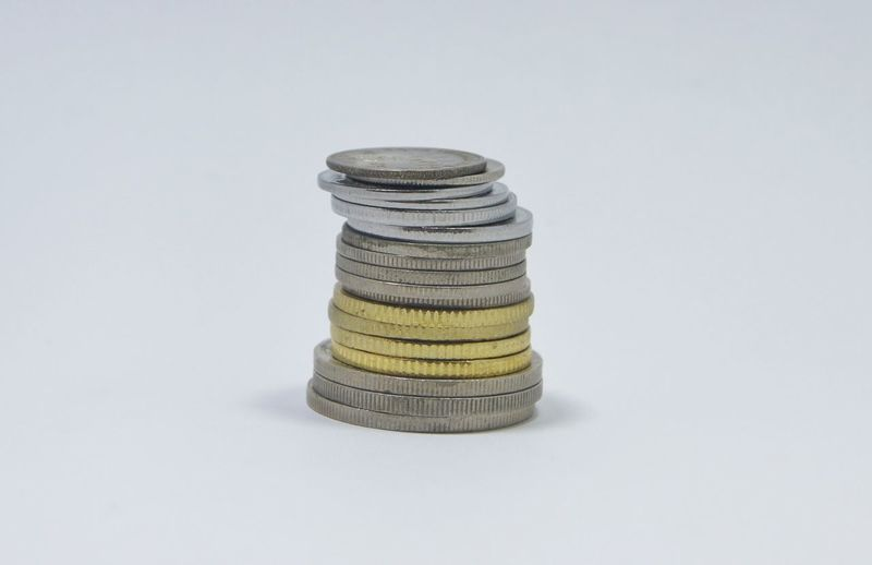 Coins Gold Account Wealth Money Business Finance Economy Coins White Background Close-up No People Studio Shot Business Finance And Industry Stack Metal Debt