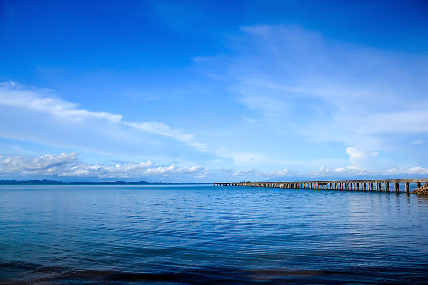 The bridge stretches to the sea. Bridge Over Water Architecture Beauty In Nature Blue Bridge Bridge View Built Structure Cloud - Sky Connection Day Landscape Sea Landscape Sea Nature Outdoors Landscape Seascape Nature No People Outdoors Scenics - Nature Sea Sky Tranquil Scene Tranquility Transportation Water Waterfront