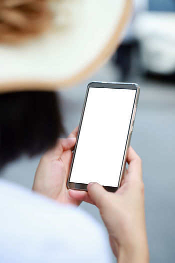 Close-up of woman using phone