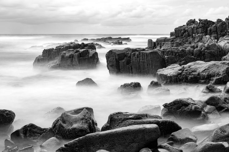 Colourful rocks at Diamond Head coast, Australia Australia Dramatic Sky Filter Seascape Photography Art Aussie Background Beach Black And White Coastal Fog Long Exposure Monochrome Ocean Outdoors Pebbles Photography Rocks Seascape Seascapes Smooth Stone Wallpaper Water Waves