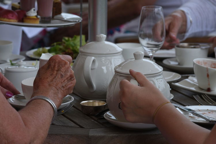 Afternoon Tea Close-up Cropped Cup Leisure Activity Lifestyles Part Of Person Personal Perspective Refreshment Restaurant Sitting Tea Unrecognizable Person People Together