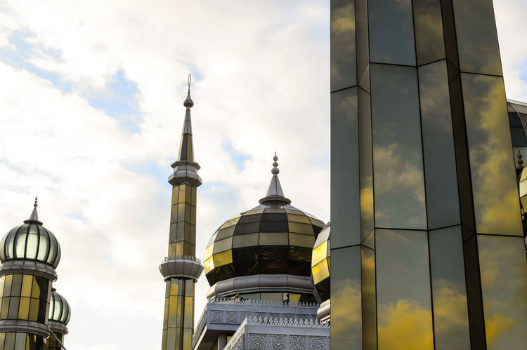 Sky reflection on dome and minarets of Crystal Mosque, Kuala Terengganu, Malaysia. City Sky Architecture Travel Cloud - Sky Dome Travel Destinations Day Modern Outdoors Mosque Minarets Reflection Place Of Worship Kuala Terengganu Terengganu, Malaysia