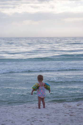 Baby Beach Photography Water Wings Beach Beauty In Nature Childhood Cloud - Sky Day Florida Full Length Horizon Over Water Little Girl Nature One Person Outdoors Real People Sand Sand And Sea Scenics Sea Sky Sunset Water Wave Waves