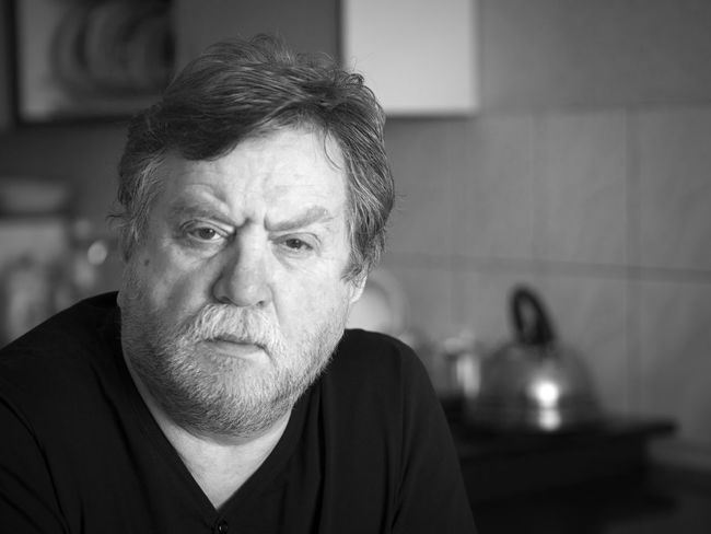 Black and white portrait of pensive mature man Man Must Pensive Adult Adults Only Beard Black And White Breaded Caucasian Close-up Day Depression - Sadness Domestic Kitchen Domestic Life Domestic Room Gray Hair Headshot Home Interior Human Face Indoors  Lifestyles One Man Only One Person Only Men People Portrait Real People Senior Adult Serious
