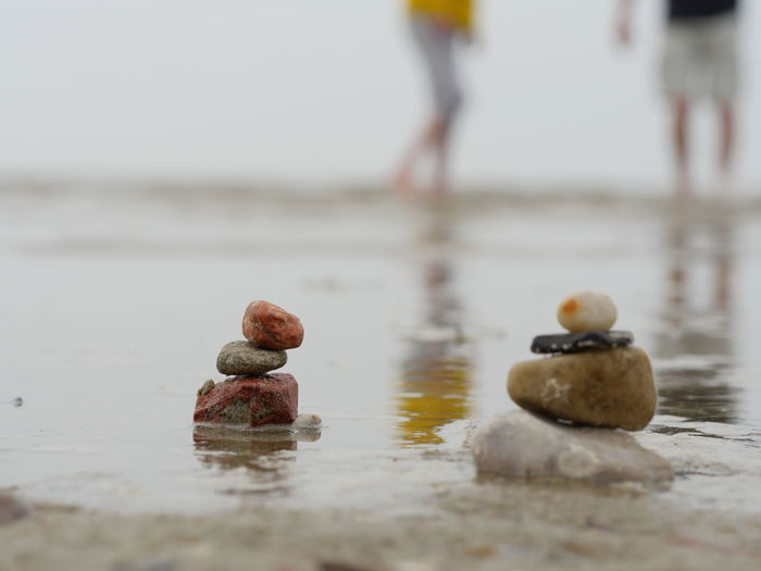 Close-up of stack of stones on beach