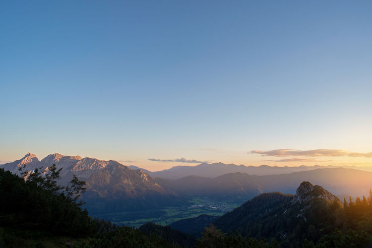Scenic landscape view of mountains against clear sky during sunset