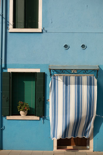 A Day in Burano A Blue House Building Exterior Close-up Flowerpot No People Outdoors Striped Curtain Travel Destinations Travel Photography Window