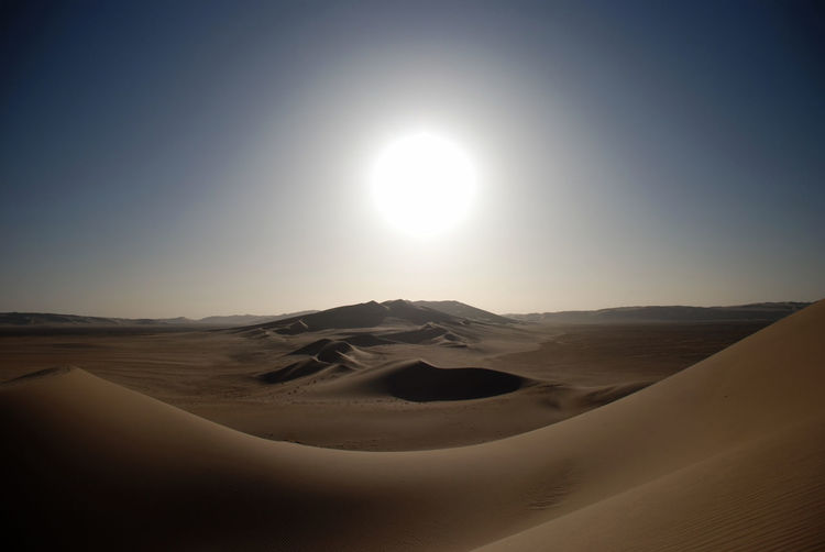 Desert Sun Arid Climate Atmosphere Clear Sky Copy Space Desert Glowing Horizon Over Land Landscape Majestic Mystery Non-urban Scene Outdoors Remote Sand Sand Dune Scenics Solitude Sun Thirst Tranquil Scene Tranquility