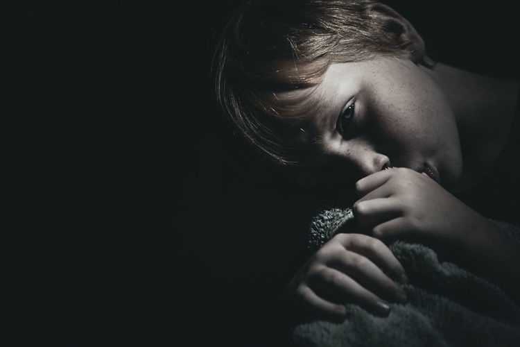 Black Background Child Childhood Close-up Contemplation Copy Space Headshot Human Face Indoors  Innocence Lifestyles One Person Portrait Real People Sadness Studio Shot The Portraitist - 2018 EyeEm Awards