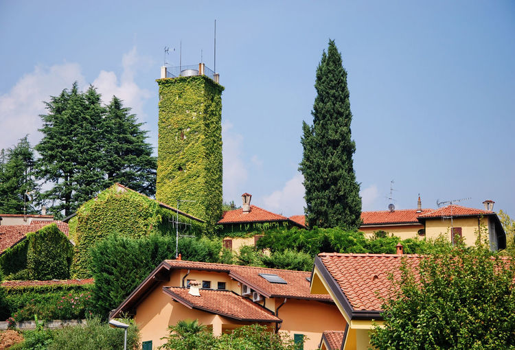 Green tower in a village named Brongio - Garbagnate Monastero, Lecco, Italy. Architecture Blue Brianza Brongio Building Exterior Built Structure Day Exterior Garbagnate Monastero Green Green Color House Idyllic Italia Italy Lecco Lombardia Lombardy No People Outdoors Sky Tall - High Tower Tree Village