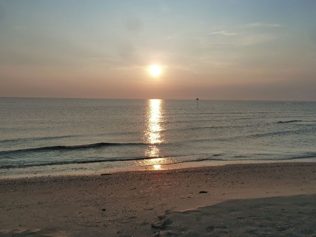 Early Morning At The Beach Beach Beauty In Nature Cloud - Sky Day Horizon Over Water No People Sand Sea Sun Sunset Tranquil Scene Travel Destinations Vacations Water