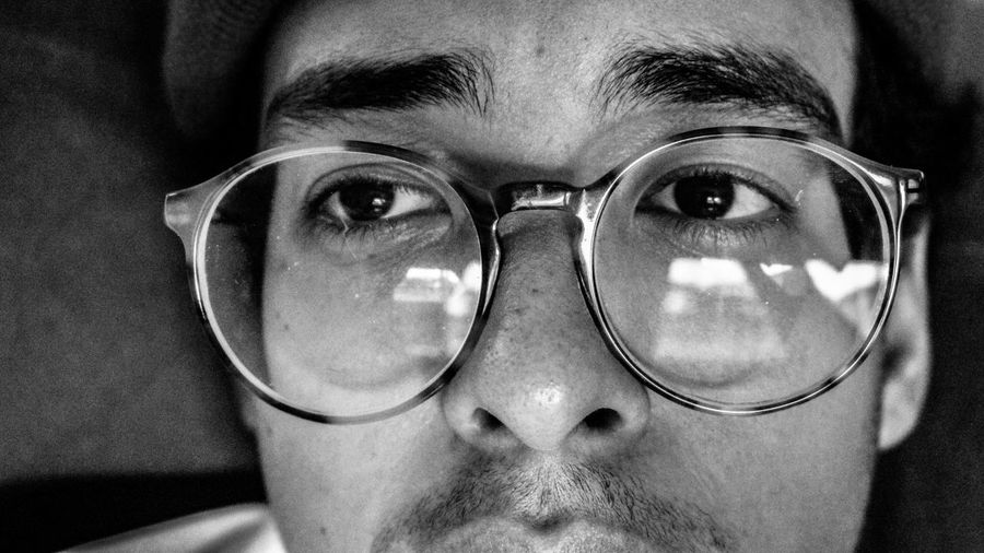 Close-up of man looking away while wearing eyeglasses