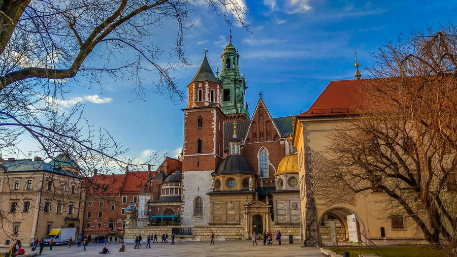 Beautiful view of Wawel cathedral in Krakow, Poland Wawel  Wawel Castle Poland Europe Cathedral Fortress Architecture Urban Skyline City Town Buildings Landmark Tourist Monument Travel Destinations Travel Card Wallpaper Blue Sky Branches Branches And Sky Winter Attractive Attraction Belfry Worship Outdoor Exterior Amazing View Built Structure Building Exterior Building Tree Sky Bare Tree Place Of Worship Religion Belief Spirituality Nature Cloud - Sky Plant History Outdoors Spire  Old Historic Gothic Medieval