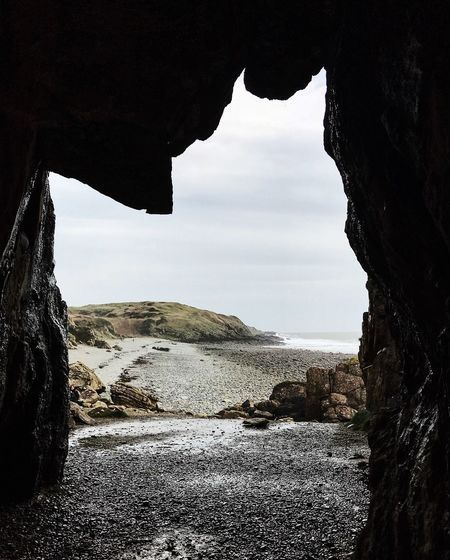 cave above pebble beach, low tide Landscape_Collection Pebble Beach Scotland The Week On EyeEm Beach Beauty In Nature Cave Day Horizon Over Water Landscape Natural Arch Nature No People Outdoors Rock - Object Rock Formation Scenics Sea Sky Tranquil Scene Tranquility Water
