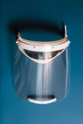 High angle view of electric lamp on table against blue background