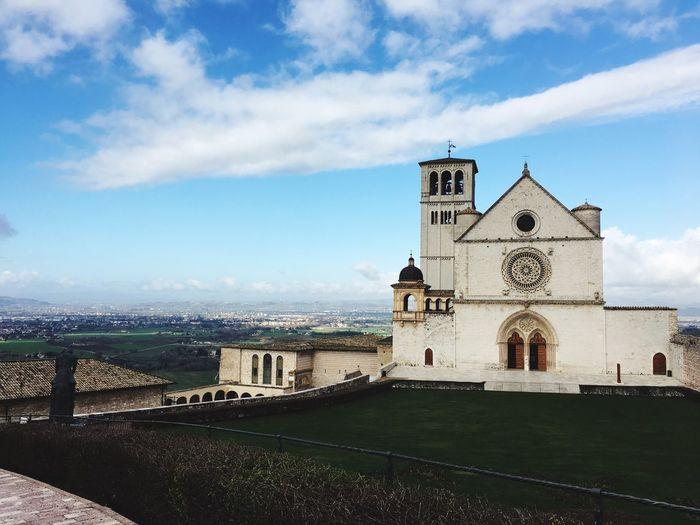 Church against blue sky in city