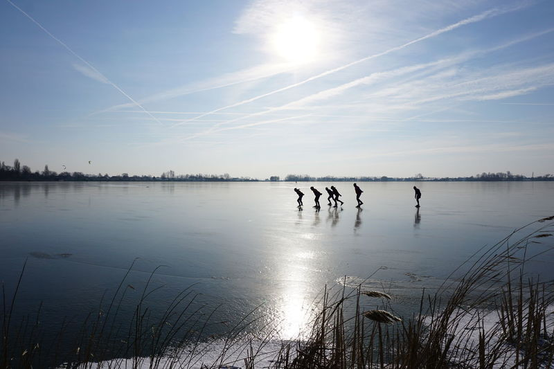 When winter comes, and the cold freezes the lake, the Dutch put on their skates and glide. Groene Hart Langeraarse Plassen Winter Lake Nature Nieuwkoop Outdoors Real People Reflection Scenics Silhouette Skating Sports Sun Sunlight Water Zuid Holland