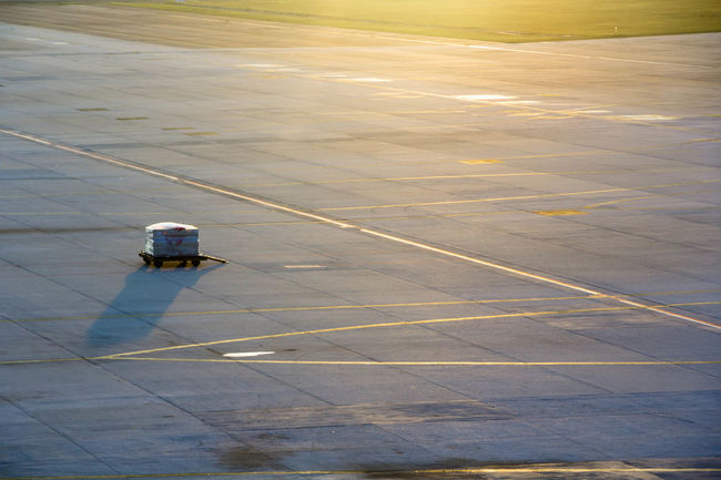 Magic Hour Airplane Airport Runway High Angle View Lagguage Luggage Trolleys Outdoors Sunrise Transportation