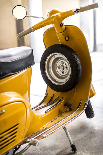 Yellow scooter parked in the garage. 60s Bokeh Photography Classic Elegant Europe Garage Italian Made In Italy Moped Motorbike Motorcycle Nostalgic  Old Old-fashioned Parked Retro Romantic❤ Scooter Style Transportation Urban Veichle Vespa Vintage Yellow