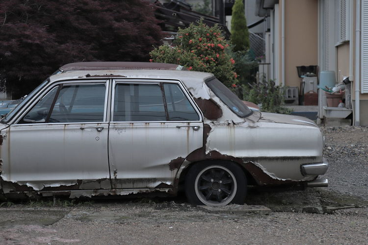 Vintage car against building in city