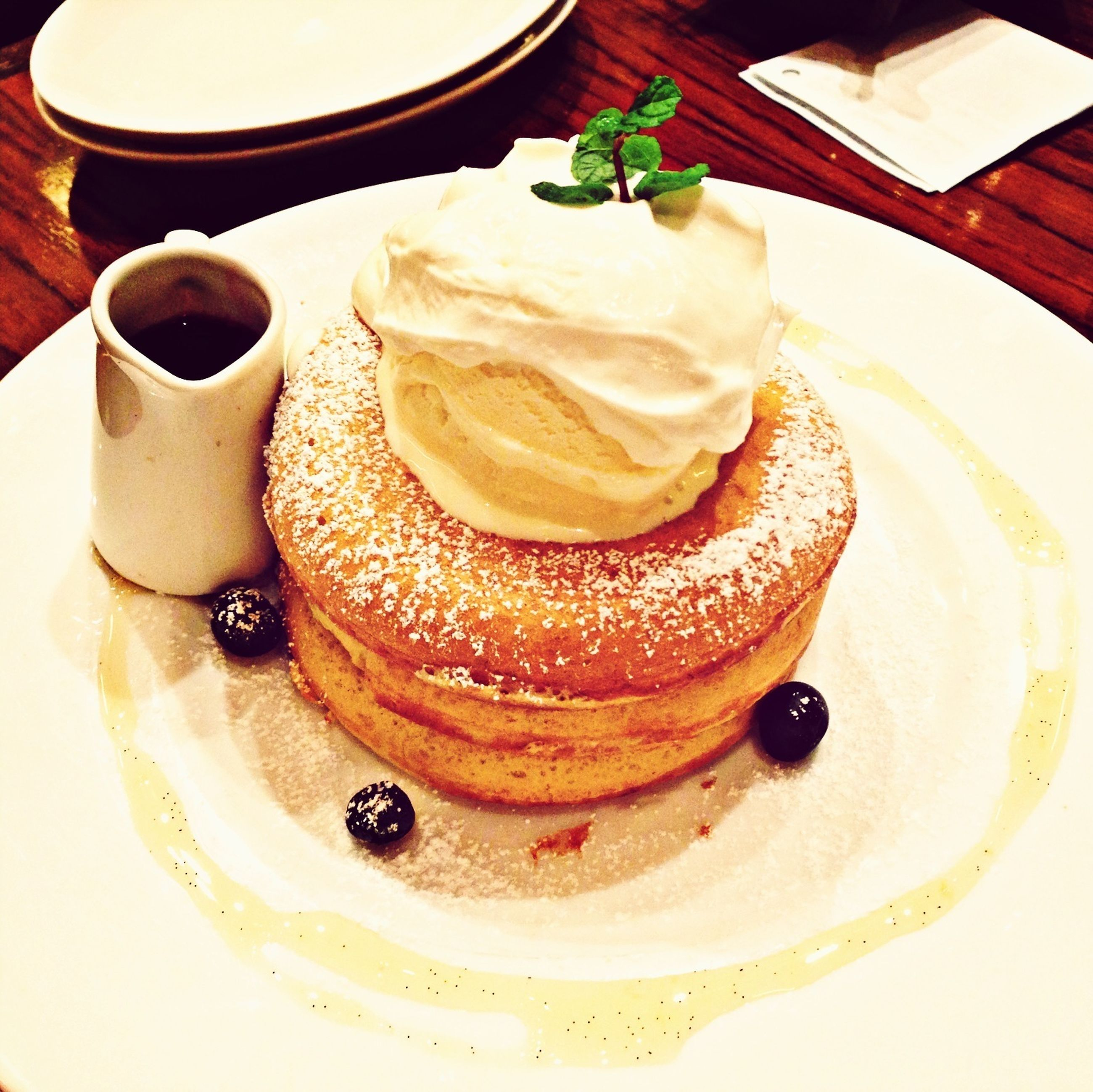 food and drink, food, indoors, sweet food, freshness, ready-to-eat, plate, dessert, still life, indulgence, table, unhealthy eating, cake, serving size, high angle view, temptation, close-up, breakfast, chocolate, refreshment