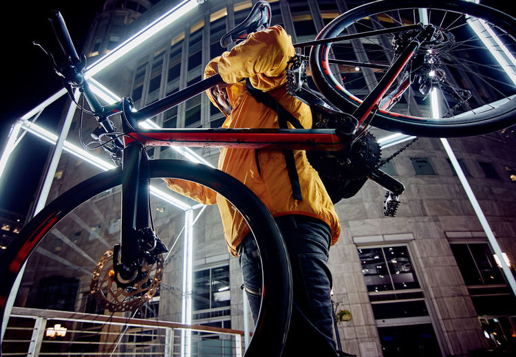 Can't Knock Tha Hustle Yellow Jacket Bicycle Cyclist Bike Cycle Nightphotography Low Angle View Winter Lights Festival 2018 Winter Lights Cycling Urban Skyline Mountain Bike Pedal Biker Handlebar Office Block Light Trail Cycling Helmet Skyscraper Cityscape Tall Office Building Skyline Uphill Bmx Cycling Tall - High Visual Creativity Adventures In The City #FREIHEITBERLIN The Portraitist - 2018 EyeEm Awards HUAWEI Photo Award: After Dark #urbanana: The Urban Playground