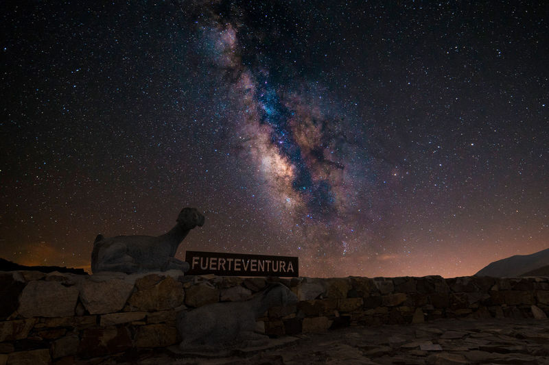Fuerteventura Landscape Galaxy Nightphotography Astronomy Astrophotography Beauty In Nature Galaxy Long Exposure Milky Way Nature Night Nightskyphotography No People Rock Rock - Object Scenics - Nature Sky Solid Space Star Star - Space Star Field Text Tranquil Scene Tranquility Western Script